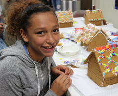 wws mentee making a gingerbread house