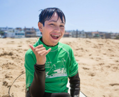 wws mentee on the beach smiling
