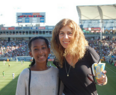 mentor and mentee at a sporting event