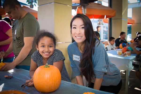 Claudia and Camila decorating pumpkins at the California Pizza Kitchen Pumpkins and Pizza Bonus Activity