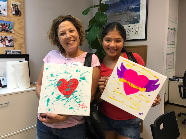 Mentor Stefanie Glassberg and her mentee Paulina at Heart to Home Art Healing program