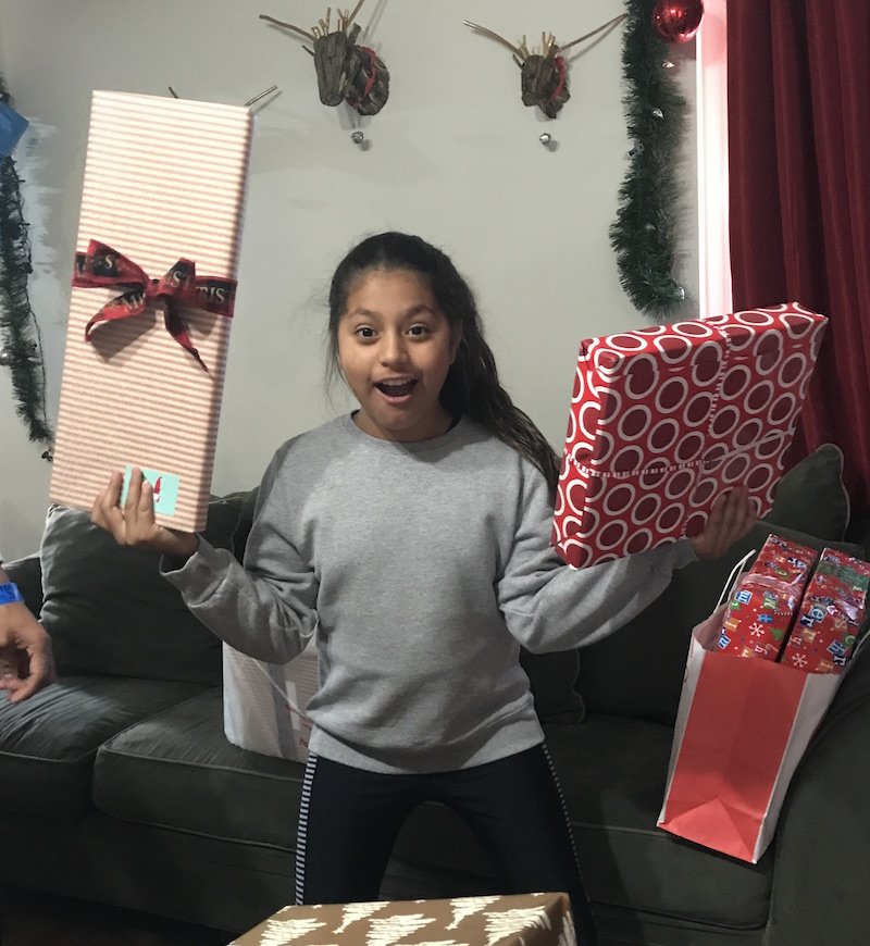 hope for the holidays mentee with her gifts