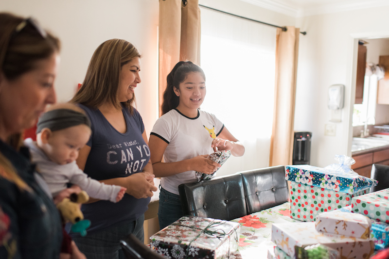 hope for the holidays family opening gifts