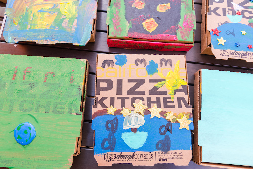 Boxes painted by Walk With Sally kids at California Pizza kitchen Bonus Activity