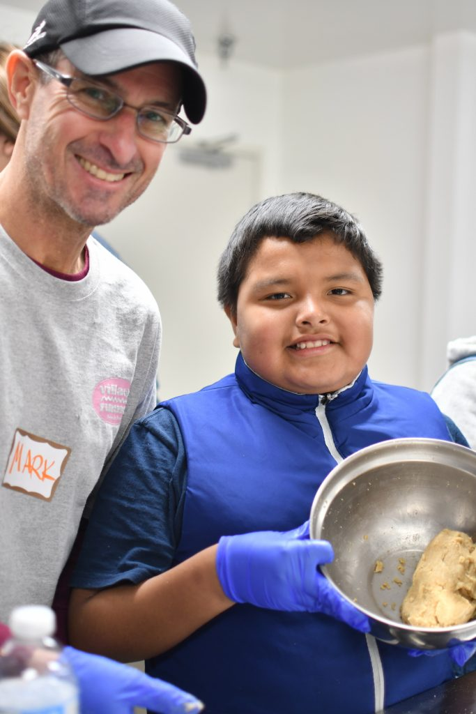 Friendship Mark (Mentor) and Yonathan (Mentee) bake cookies from scratch at Walk With Sally's Friendship Activity at Mychal's Learning Place in Hawthorne, Los Angeles, California