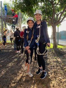 Walk With Sally Mentorship, Emma and Megan, awaiting their fates on the ropes course during our Adventure Plex friendship activity