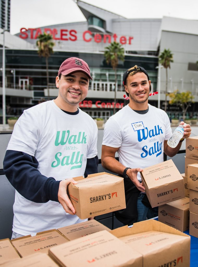 Walk With Sally volunteers hand out lunches to families impacted by cancer in Los Angeles