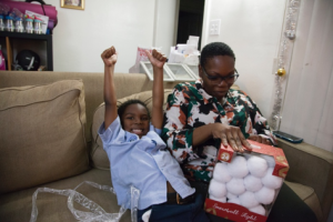 Avery receiving his snowball kit from donor and supporter, Lee Ann.
