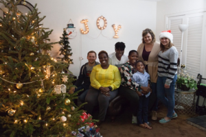 Repeat donor, Lee Ann, and her family drop off holidays gifts to Robinson Family. Both boys are mentees in the Walk With Sally mentoring program.